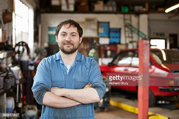 Portrait of junior car mechanic