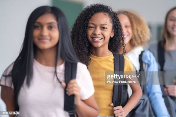 a portrait of junior high students standing in a line - children only stock pictures, royalty-free photos & images