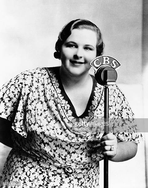 Portrait of Kate Smith American singer popular on radio during the 1930s and 1940s Photograph shows her holding CBS microphone