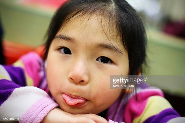 portrait of kid with funny face - tongue stock pictures, royalty-free photos & images