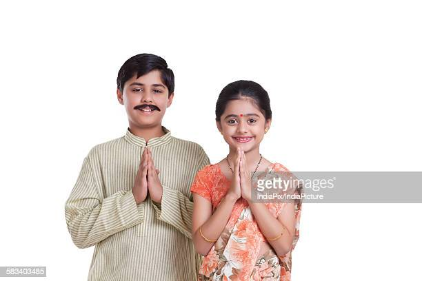 Portrait of kids dressed as husband and wife greeting