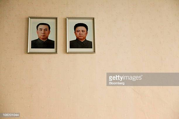 A portrait of Kim Il Sung founder of North Korea left and Kim Jong Il leader of North Korea hangs at Sunan International Airport in Pyongyang North...