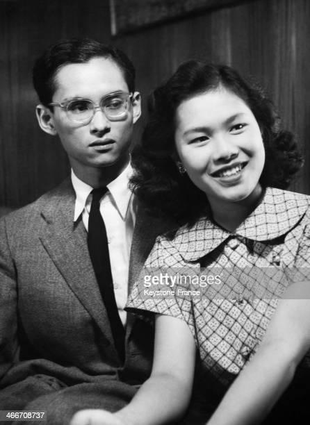 Portrait of king Bhumibol Adulyadej of Thailand aka Rama IX with his future wife Sirikit Kitiyakara in Pully Switzerland in 1949 The king had...