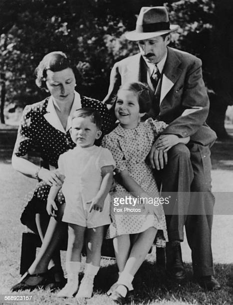 Portrait of King Boris III of Bulgaria with his wife Giovanna and his children Crown Prince Simeon and Princess Marie Louise in a garden together...