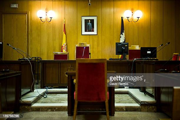 A portrait of King Juan Carlos of Spain hangs on the wall at the Palma de Mallorca courtroom where The Duke of Palma Inaki Urdangarin will be...