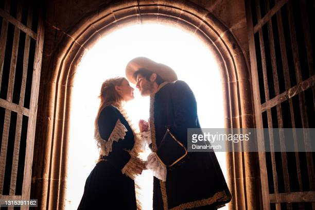 portrait of kissing romeo and juliet with bright back light - romeo stock pictures, royalty-free photos & images