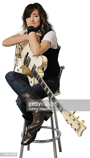 Portrait of KT Tunstall posing with her Gretsch White Falcon guitar backstage at the Hard Rock Calling festival on June 29 2008 in London