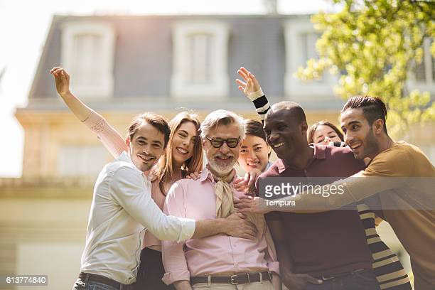 portrait of large group looking at camera. - capital cities stock photos and pictures