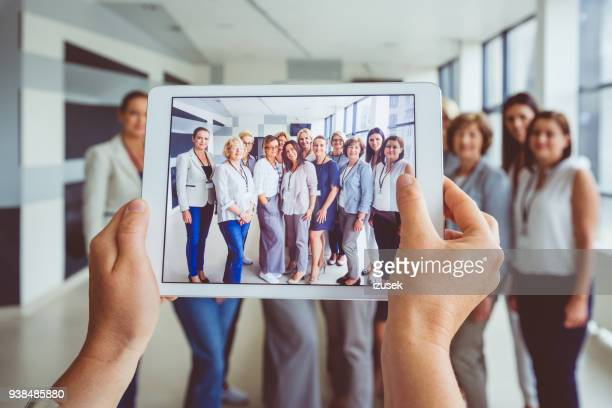 Portrait of large group of happy women after seminar