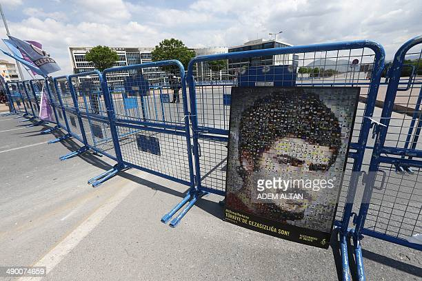 A portrait of late Ali Ihsan Korkmaz is seen outside a courthouse in Kayseri on May 12 2014 Emel Korkmaz the mother of Ali Ihsan Korkmaz a young...