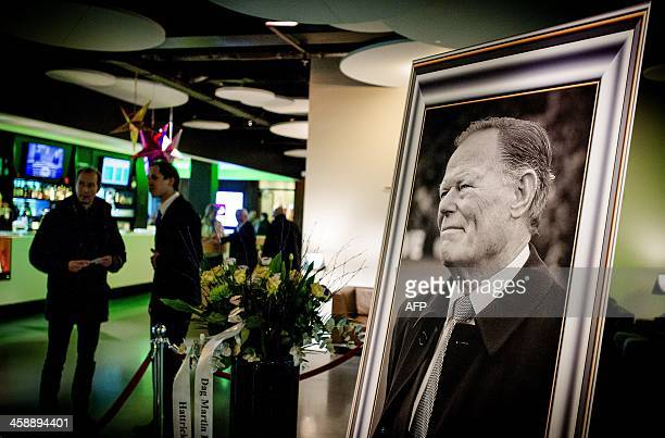 A portrait of late former football player Martin Koeman is displayed at the entrance of the Euroborg stadium before the Dutch Eredivisie match...
