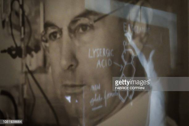 A portrait of late Swiss chemist Albert Hoffman is seen during an exhibition entitled 'LSD the 75 Years of a Problem Child' at the Swiss National...