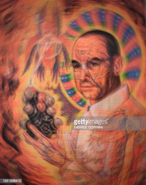 "Portrait of late Swiss chemist Albert Hoffman Packages is seen on a collection of LSD blotting paper shown during an exhibition entitled ""LSD, the 75..."