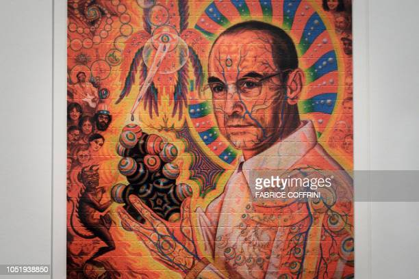 "Portrait of late Swiss chemist Albert Hoffman Packages is seen on a collection of LSD blotting papers shown during an exhibition entitled ""LSD, the..."