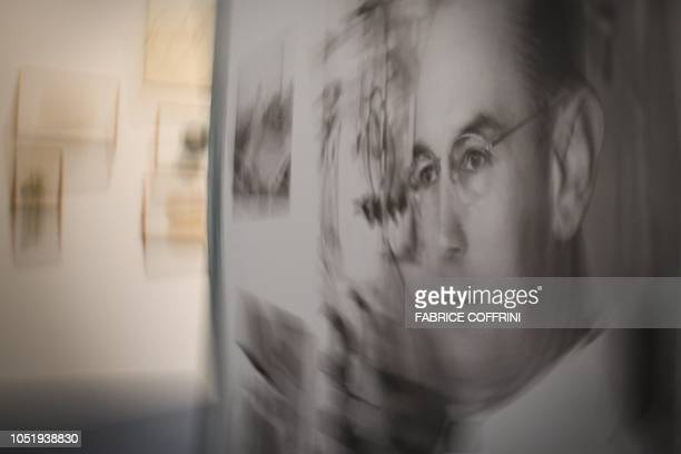 A portrait of late Swiss chemist Albert Hoffman who accidentally discovered LSD is seen during an exhibition entitled 'LSD the 75 Years of a Problem...