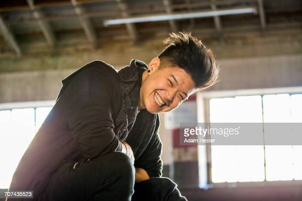 portrait of laughing androgynous asian man - non binary gender stock pictures, royalty-free photos & images