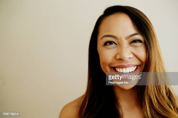 portrait of laughing asian woman - filipino ethnicity and female not male stock pictures, royalty-free photos & images
