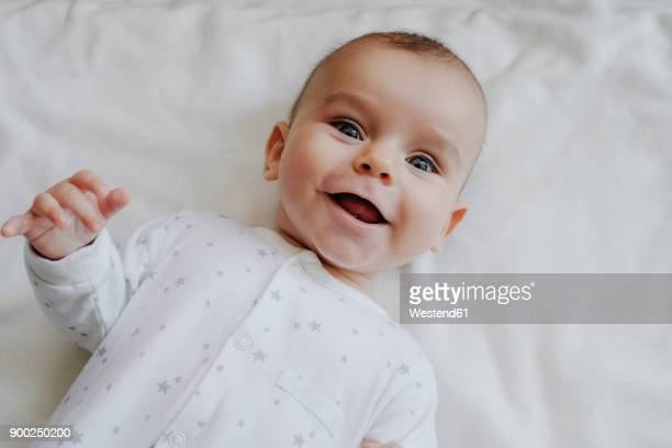 portrait of laughing baby boy - lying on back photos stock pictures, royalty-free photos & images