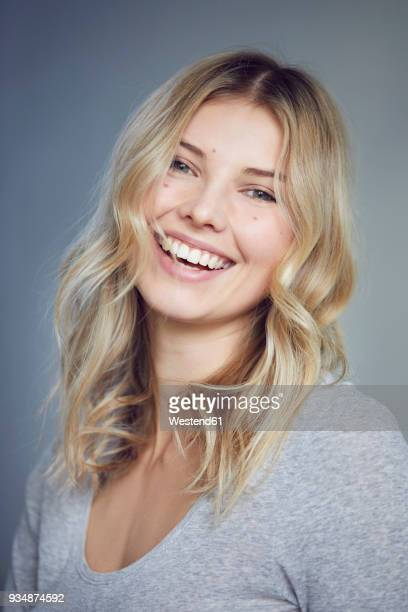 portrait of laughing blond woman with moles - head cocked stock pictures, royalty-free photos & images