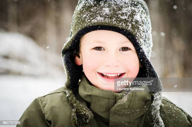 portrait of laughing boy (6-11 months) looking at camera - 6 11 months stock pictures, royalty-free photos & images