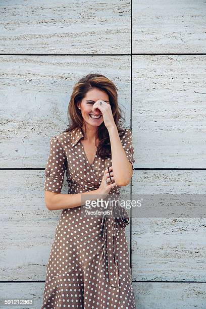 Portrait of laughing brunette woman outdoors