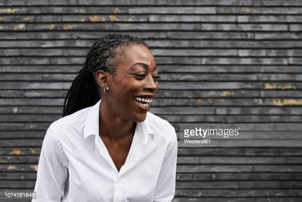 portrait of laughing businesswoman  wearing white shirt - 45 49 ans photos et images de collection