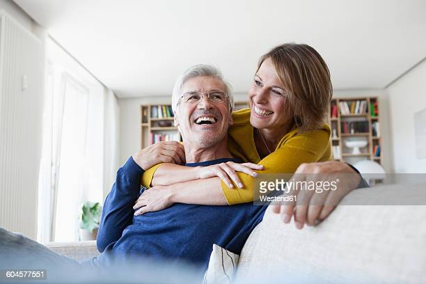 Portrait of laughing couple in the living room