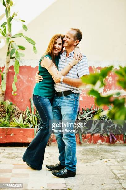 Portrait of laughing embracing mature couple