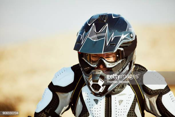 Portrait of laughing female dirt biker rider
