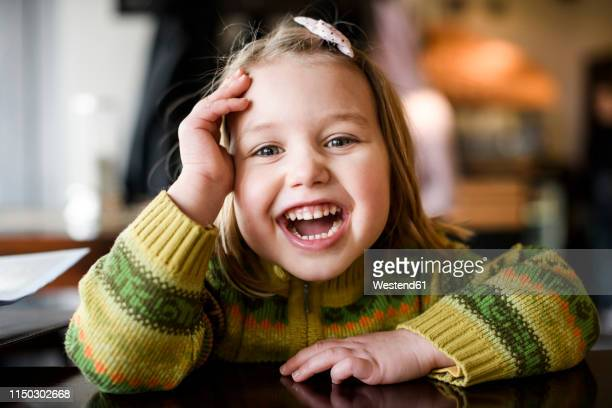 portrait of laughing girl - lachen stock-fotos und bilder