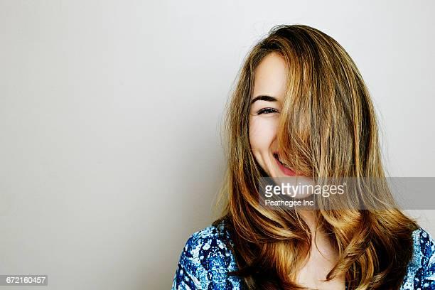 Portrait of laughing Hispanic woman