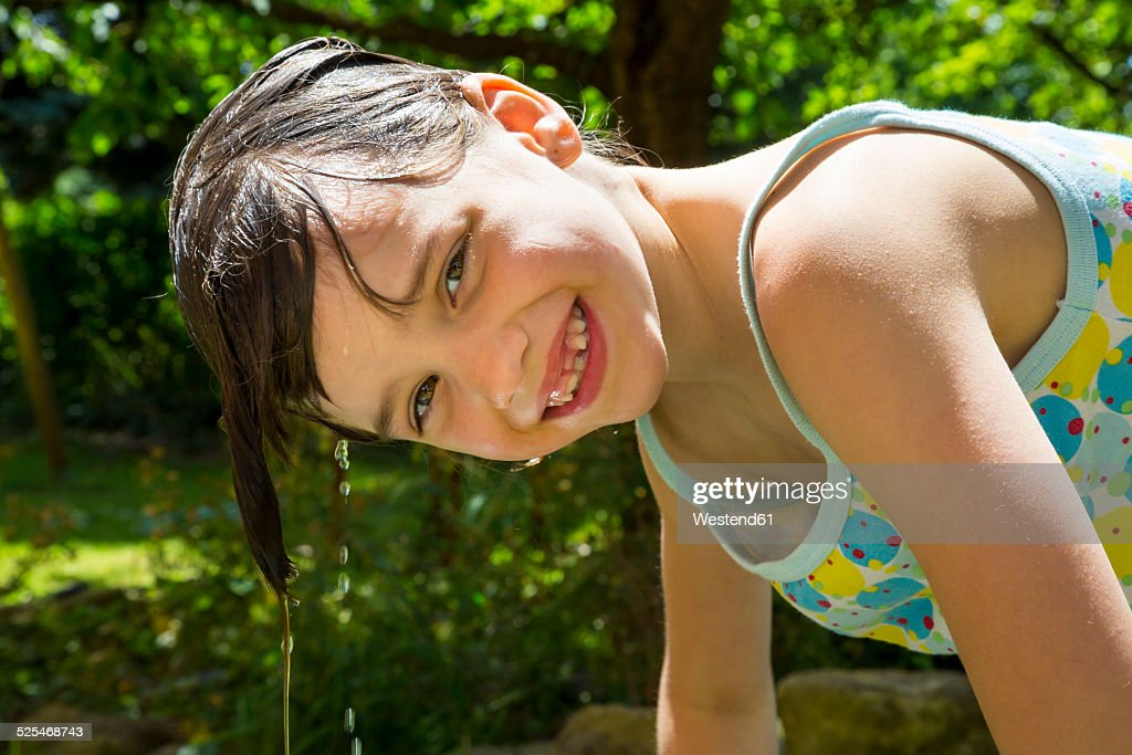 Portrait Of Laughing Little Girl With Dripping Wet Hair In The Garden Stock Photo -6435