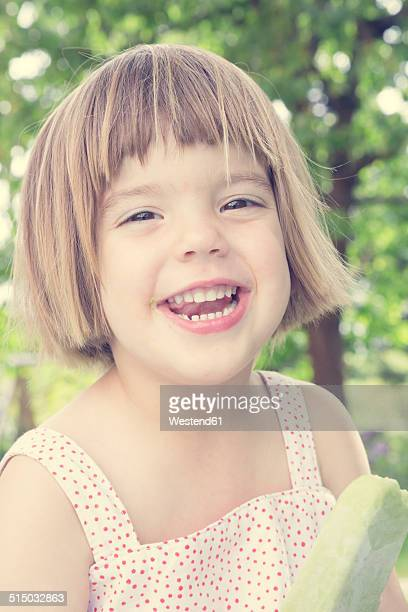 Portrait of laughing little girl with ice lolly