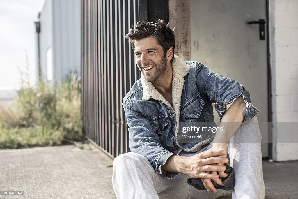 Portrait of laughing man wearing denim jacket : Stock-Foto