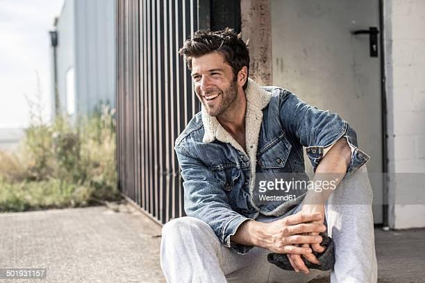Portrait of laughing man wearing denim jacket