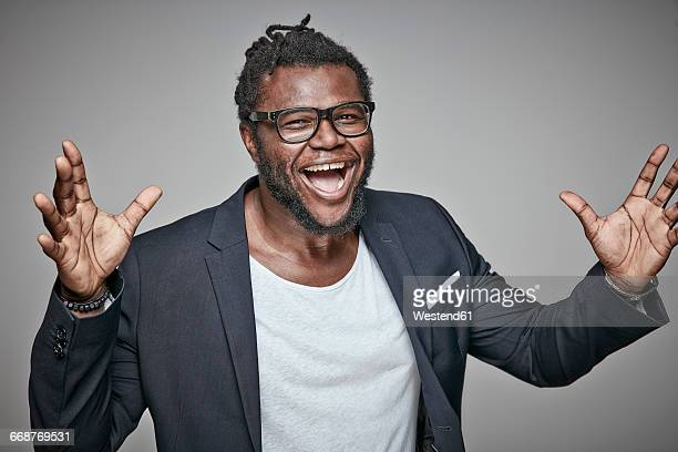 portrait of laughing man wearing glasses and jacket - black jacket stock photos and pictures