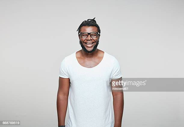 Portrait of laughing man wearing glasses and white t-shirt