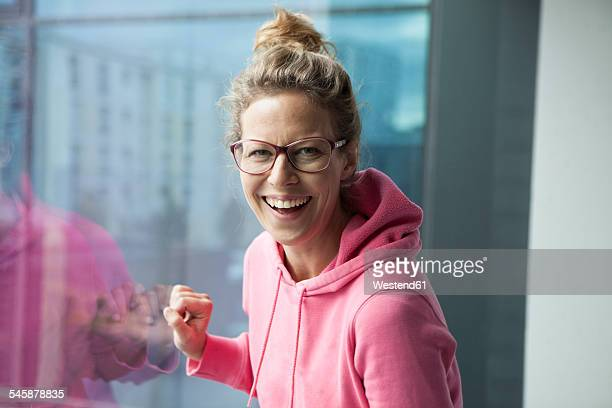 Portrait of laughing mature woman with pinkhooded jacket