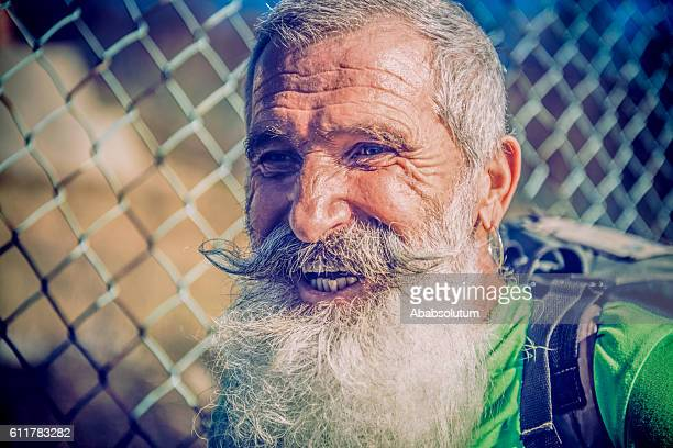 Portrait of Laughing Senior Paraglider with Beard, Mountains, Alps, Europe