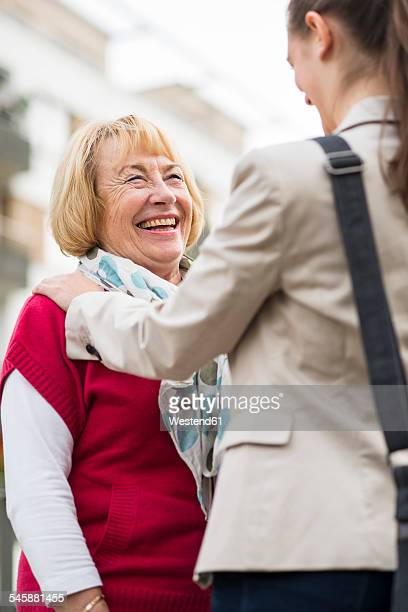 portrait of laughing senior woman communicating with her granddaughter - doing a favor stock pictures, royalty-free photos & images