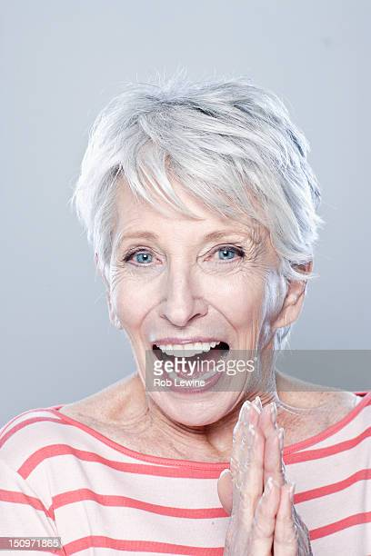 Portrait of laughing senior woman, studio shot