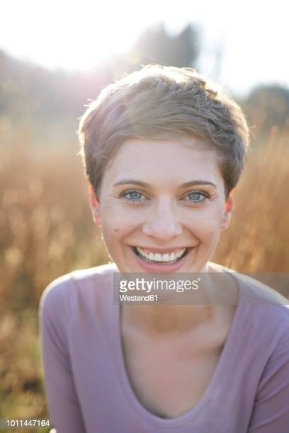 Portrait of laughing woman in nature