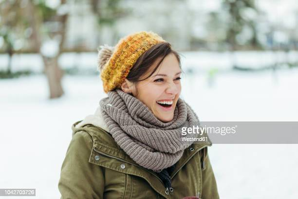 portrait of laughing woman in the snow - schal stock-fotos und bilder