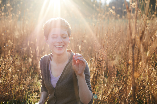 Portrait of laughing woman relaxing in nature - gettyimageskorea
