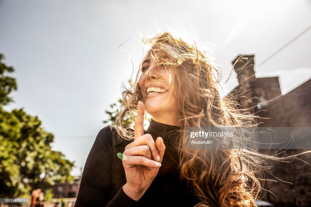Portrait of laughing woman with blowing hair : Stock-Foto