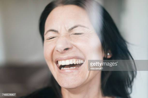 Portrait of laughing woman with eyes closed