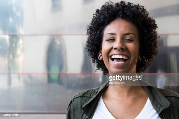 portrait of laughing woman with piercings - nose piercing stock pictures, royalty-free photos & images