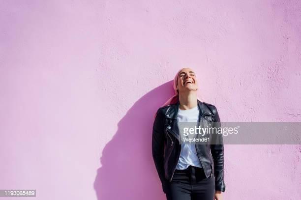 portrait of laughing woman with pink headscarf, has cancer - cancer de piel fotografías e imágenes de stock