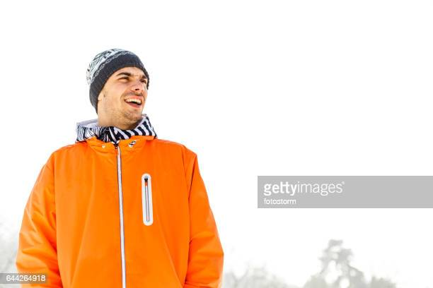 Portrait of laughing young man on snow