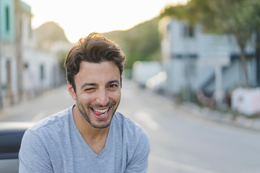 Portrait of laughing young man pulling funny faces - gettyimageskorea